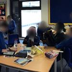 Children using ipad in class